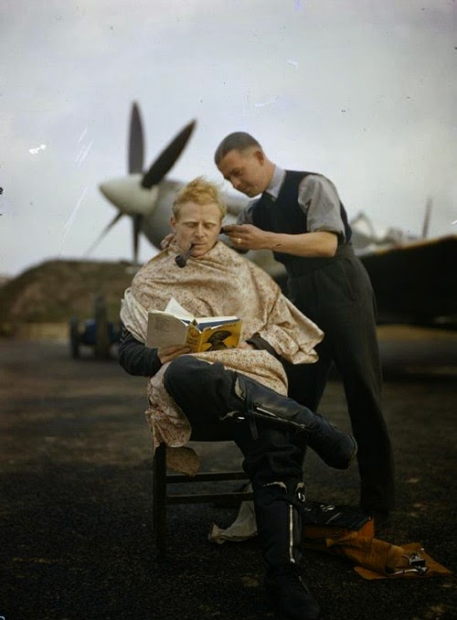 Royal Air Force, pilot getting haircut, between missions (1942).