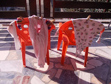 Three-year-old Alma is drying the laundry