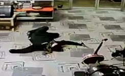 Robber plays dead as store owner points a gun at his head