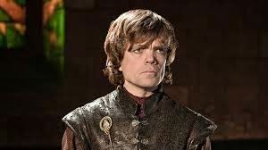 Tyrion Lannister, younger, blonde haired little person with a serious face