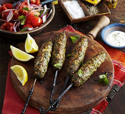 Use a North African spice mix to flavour these skewered meat kebabs and serve with wraps Spiced lamb koftas with mint & tomato salad recipe