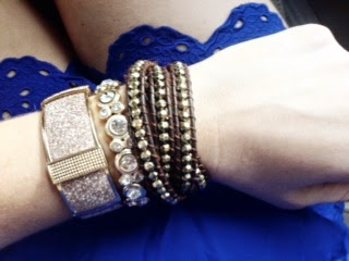 gold, brown, and pink arm jewelery and bracelets