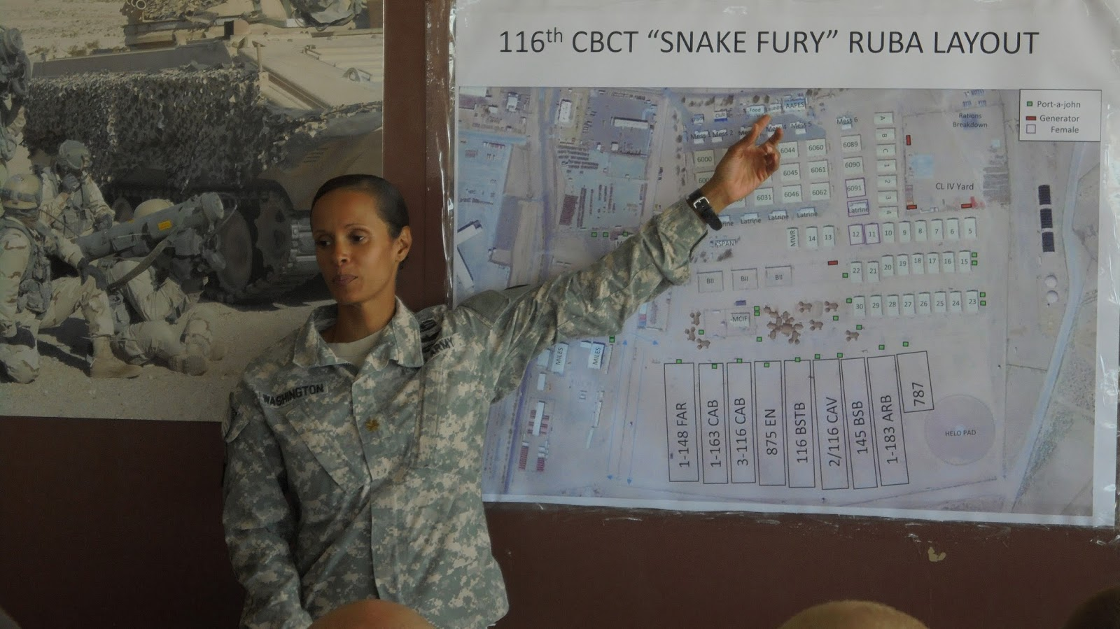 maj nicole washington 116th cbct senior personnel officer points out the location of the post exchange to the new 2 116 cav soldiers as they in process on