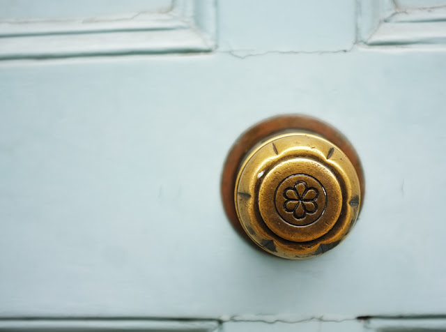 Brass decorative door knob - Photograph by Tim Irving
