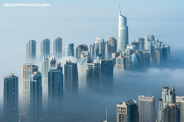 Photo of Dubai Marina buildings in the fog