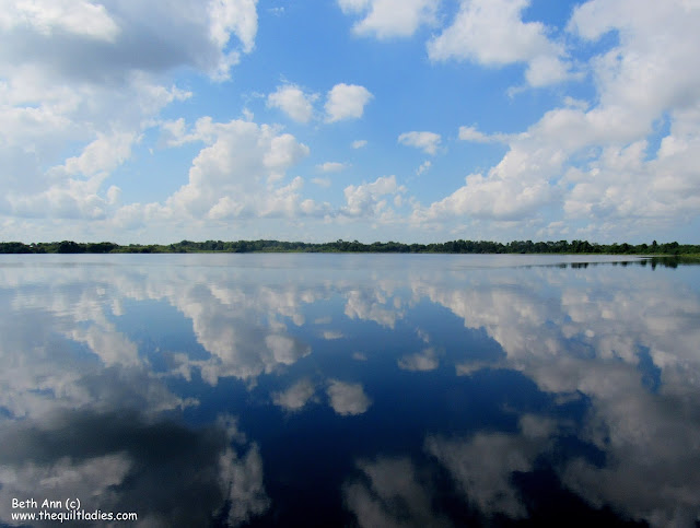 On the River a Blue Sky Reflection by Beth Ann Strub  (c)