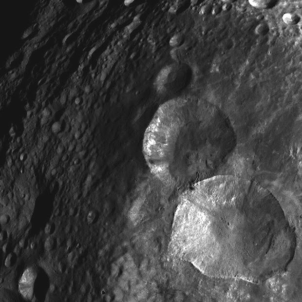 Close-up view of Snowman Craters on Asteroid Vesta