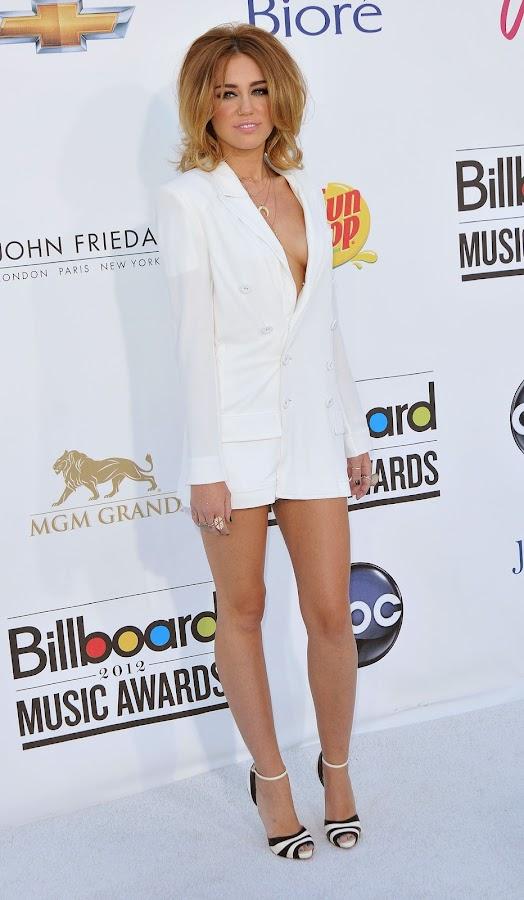 Miley Cyrus leggy in Jean Paul Gaultier jacket dress