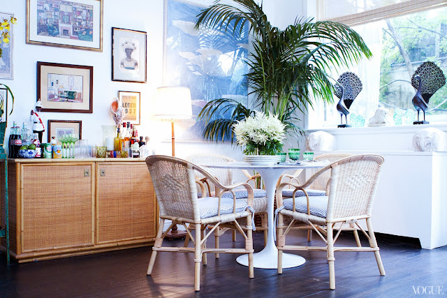 Rebecca de Ravenel's dining room after being redecorated with a Saarinen tulip table, rattan chairs, woven buffet cabinet and palm tree