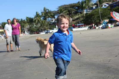 toddler running on beach
