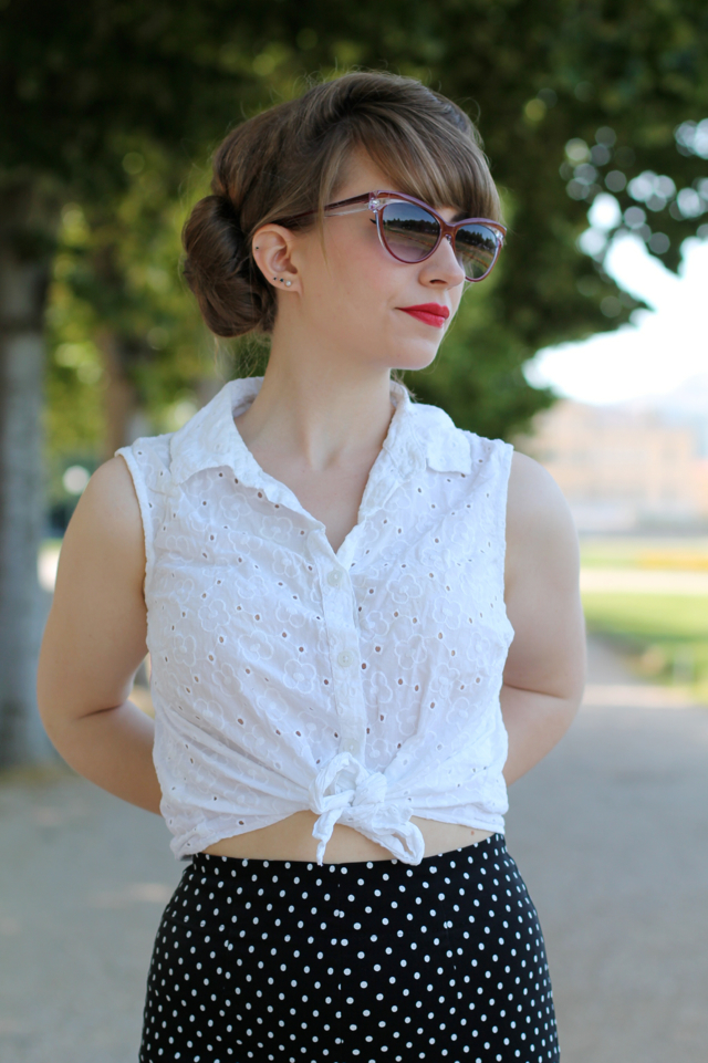 Red catseye glasses, white broderie anglaise tie shirt, Hell Bunny polka dot capris