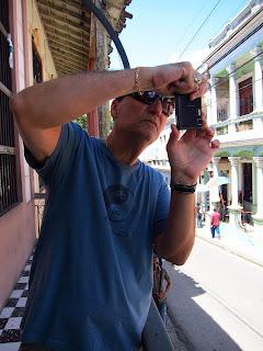 Santiago de Cuba Pedro photographing from a balcony