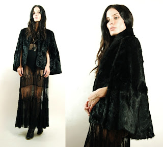 Vintage 1950's black fur cape with front slit armholes.