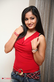 Madhavi Latha  Pictures in Red Sleeveless Top and Jeans at Muse Art Gallery  0004.jpg