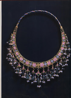 Eighteenth-century Mogul enameled gold necklace with pearls and emerald beads. Once precious stones were pierced, they lost some of their intrinsic value, thus such necklaces conveyed their owners' great wealth. The neck-laces of gems and metals created by jewelers of the Mogul court are among the most elaborate ever made, yet their designs are unusually well integrated and not over-whelmed by details.