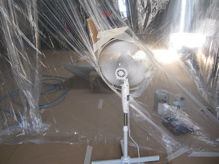 Spray booth made of plastic drop sheets with fan