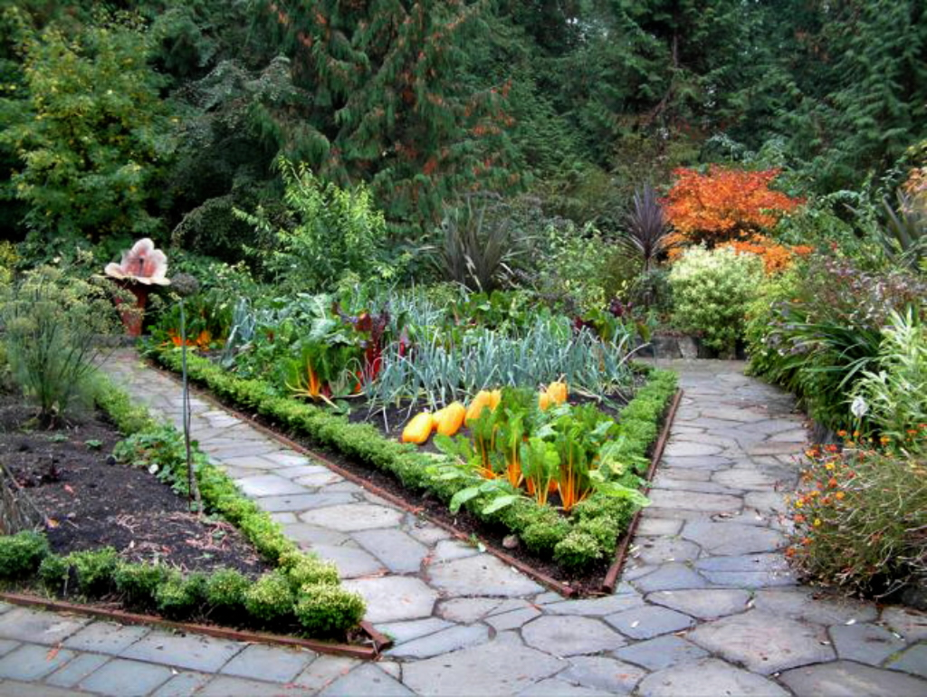 Gardener in a forest potager inspiration for your garden for Vegetable garden landscaping