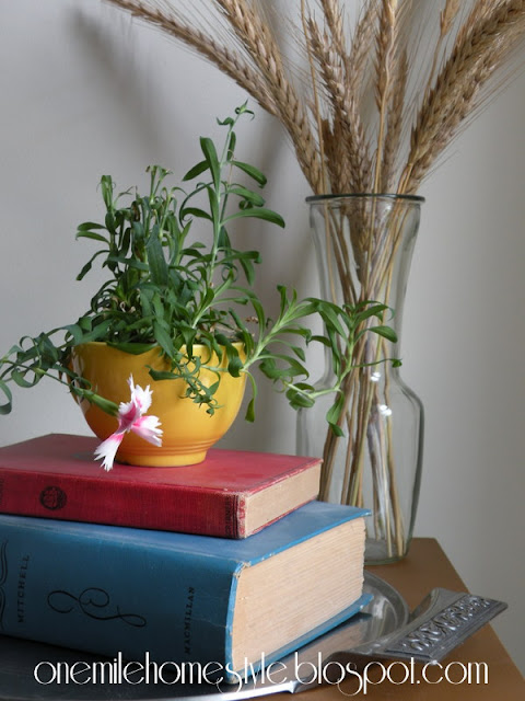 Old books and flowers tabletop