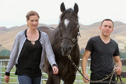 L-R: Miranda Dravitzki, 26, Lenin the Brown, Shannon Doyle, 34, both jockeys, also a couple, pictured at Timoti Farms, Havelock North, stables run by John Bary. photograph