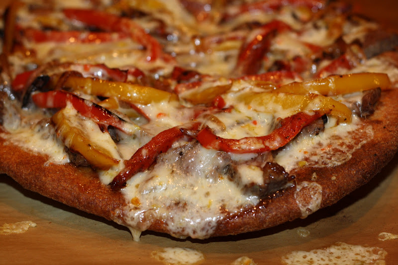 steak pizza with peppers and onions 35 minutes title=