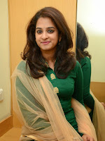 Nanditha Raj glamorous photos in green-cover-photo