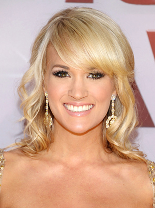 Carrie Underwood is country glam with soft ringlets and a sweeping bang.
