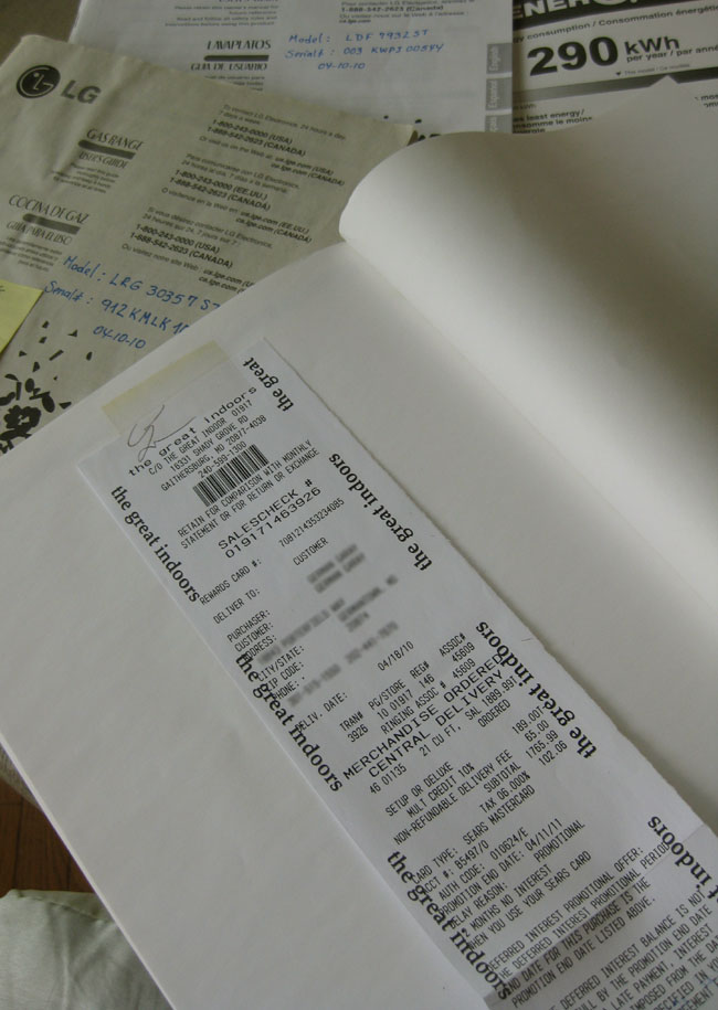 attach receipts to the end of owner's manuals for big appliances- you'll need them