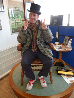Photo of Richard Gottfried sitting in the Winston Churchill Chair at the High Wycombe Chair Making Museum