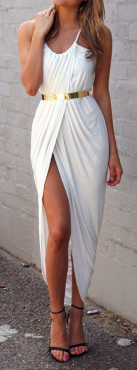 White maxi dress with golden belt and sandals