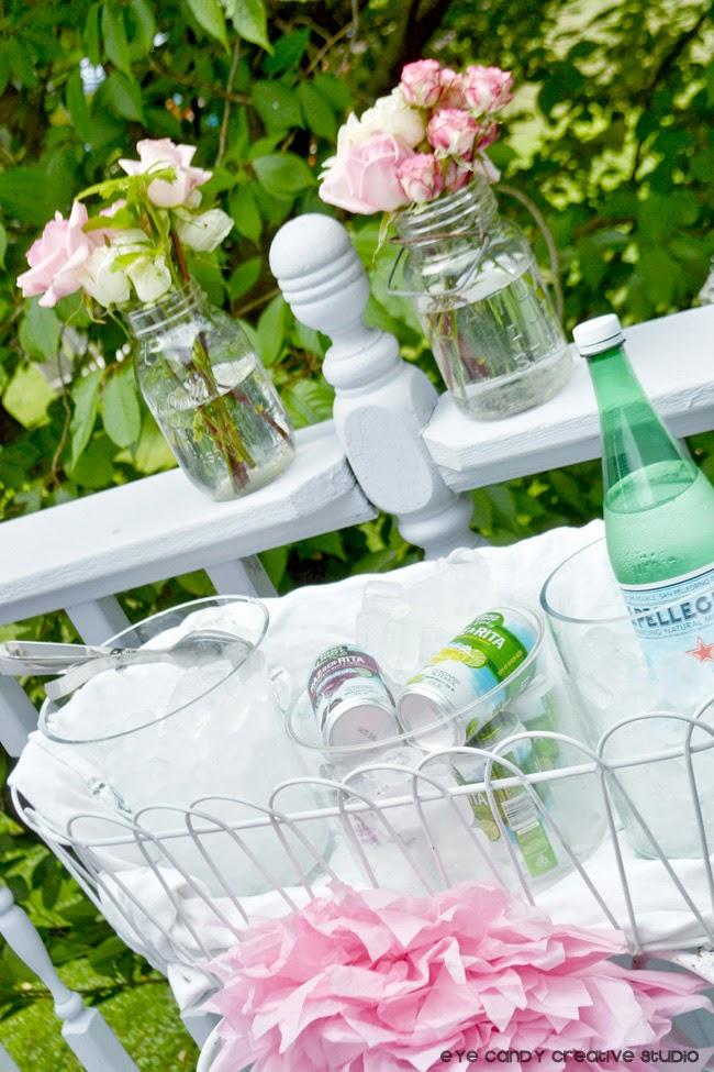 drink ideas for bridal shower, tissue flowers, bottled water, ice bucket