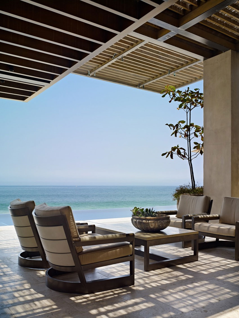 Terrace furniture and ocean view from Gorgeous modern stone house on the beach