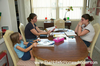 Family studying at dining room table