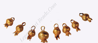 Eight pendants formed in the shape of pomegranates, a common her in the repertoire of late Canaanite jewelry. According to some historians, pomegranates were important in Jewish custom because the fruit's approximately 613 seeds represent the 613 commandments in the Torah. Some scholars even believe the pomegranate represents the Tree of Life in the Garden of Eden.