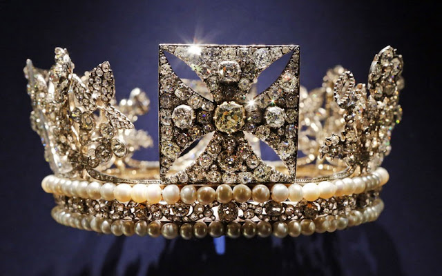 Alongside official black and white photographs the exhibition features private movies filmed behind the scenes for the Queen, that show the personal story behind the pomp and ceremony. Above, the diamond diadem, made of diamonds, pearls, silver and gold, worn by Queen Elizabeth II on her way from Buckingham Palace to Westminster Abbey for her 1953 Coronation.