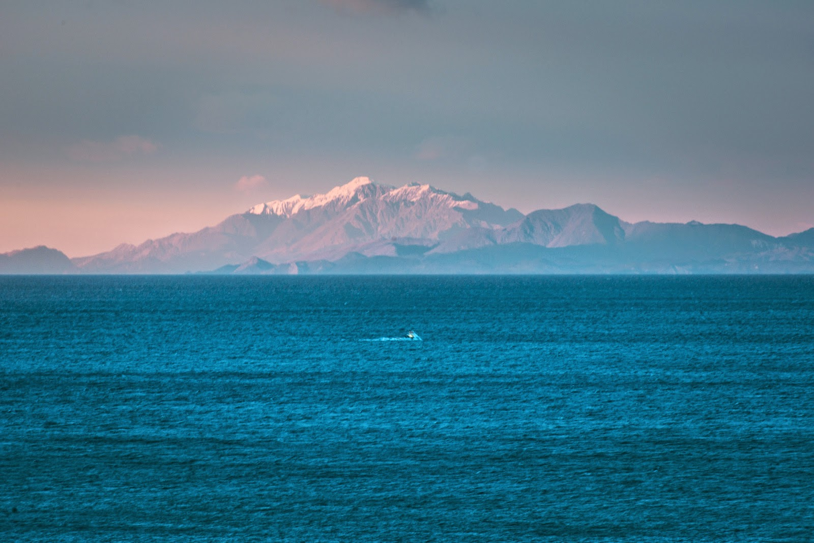 Kaikoura mountain, fishing boat and Cook Strait