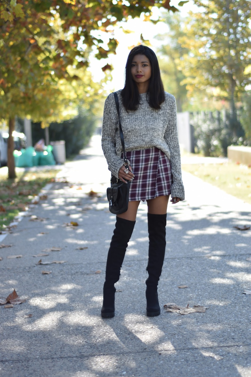 k meets style TiverIsland thigh boots topshot tartan skorts and cozy sweater