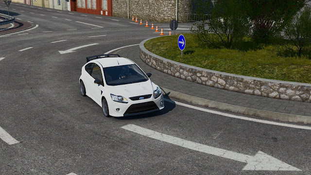 Screenshot of white car making a turn in video game Project CARS