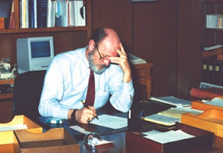 Dr. Friel at his desk.