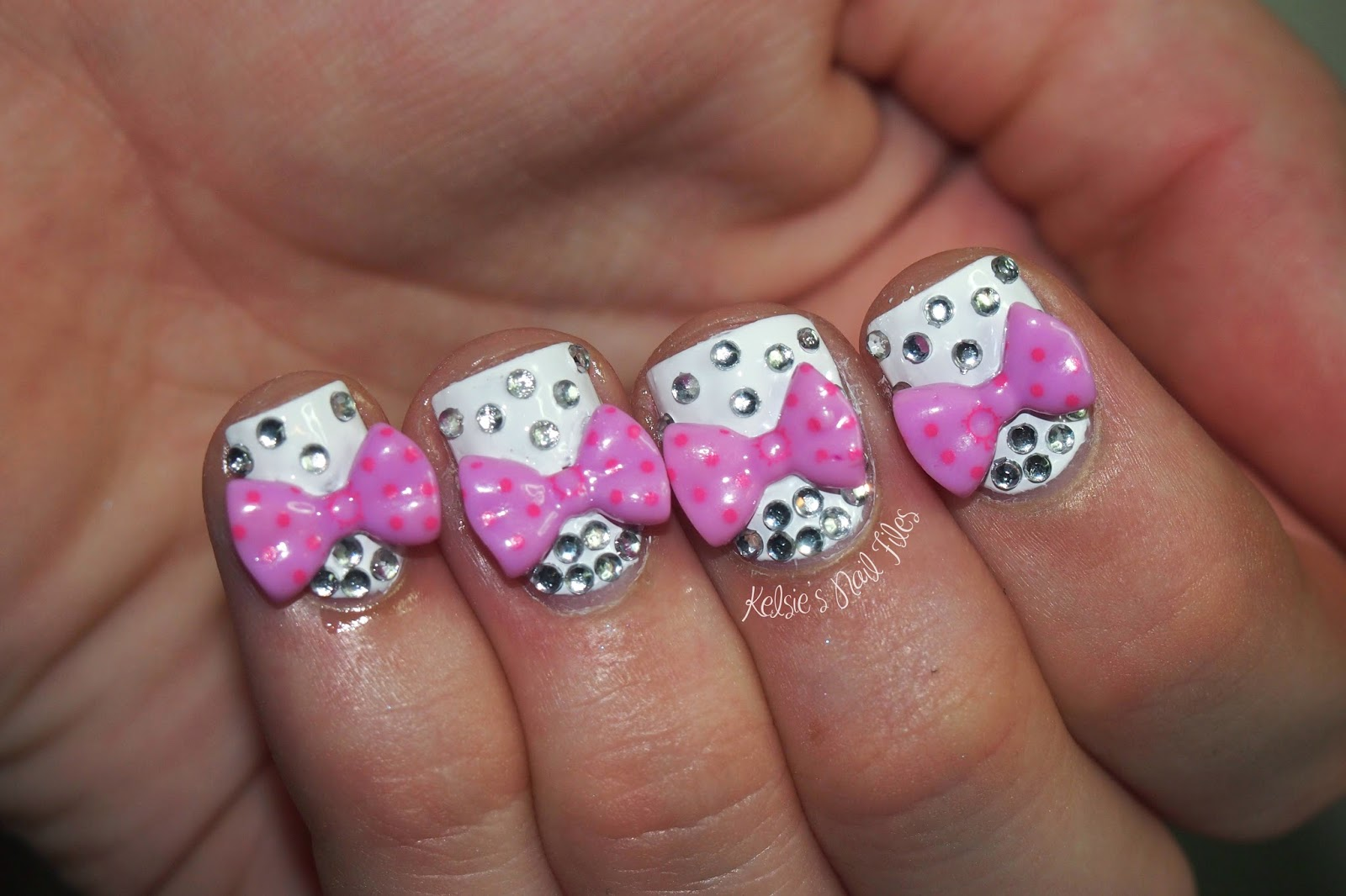 Kelsies nail files february 2014 i started with a base of opi alpine snow and then using nail art glue i placed each bow and then followed with small rhinestones also from born pretty prinsesfo Choice Image