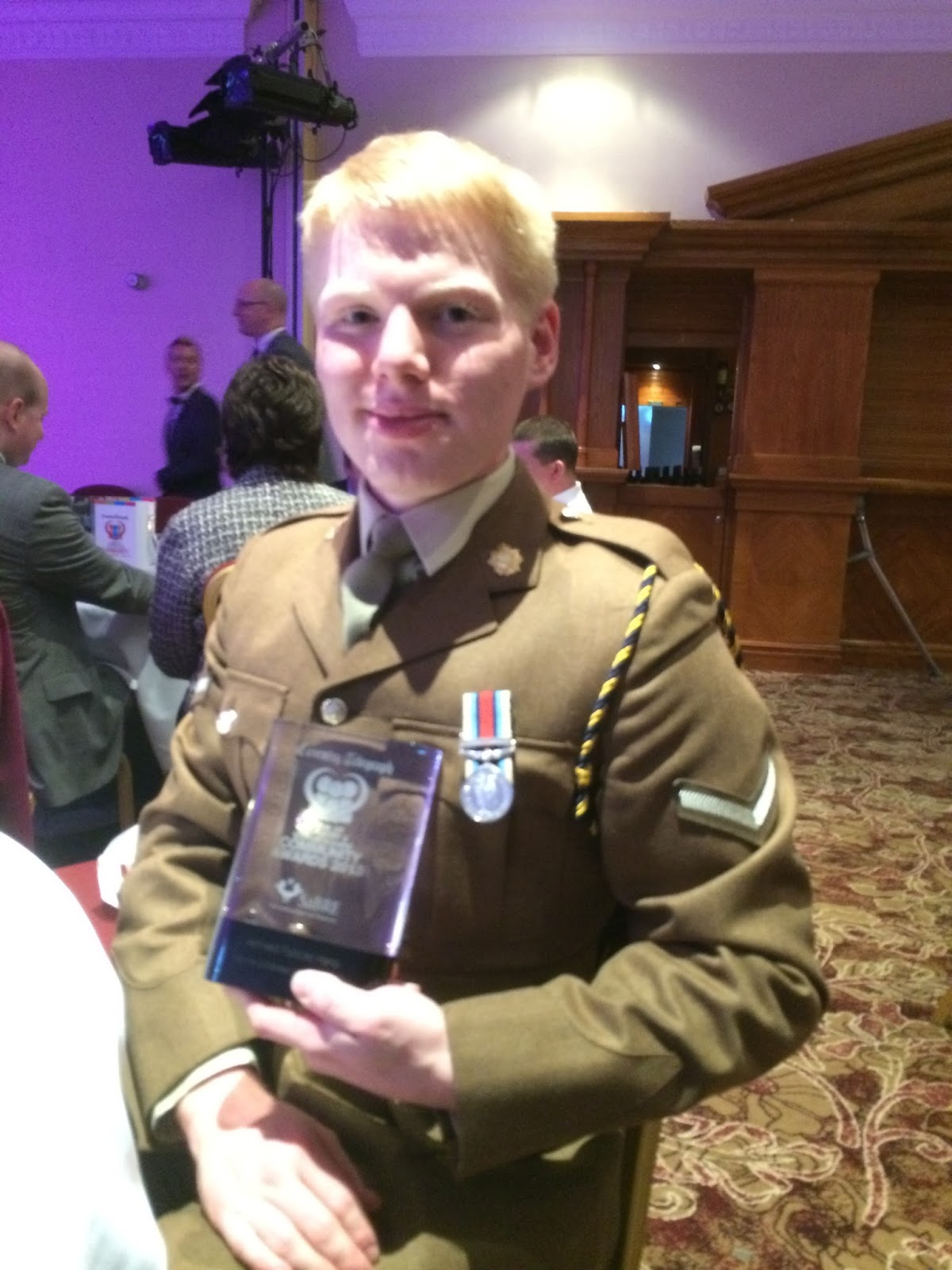 LCpl Hoskins of 159 Supply Regiment holding his award at the Pride of Coventry awards ceremony.