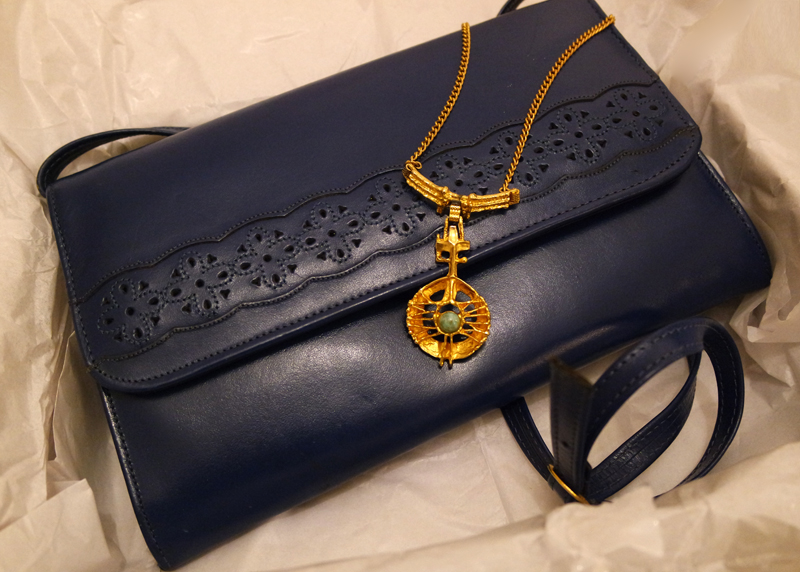vintage navy bag and gold necklace