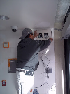 Operations Staff Working on the Wiring of the Door Openers