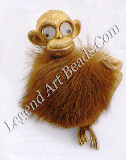 Costume jewelry can come in some bizarre forms. This little monkey, from a range of animals made in the 19505, has mink for his body and articulated googly eyes. 135-55 (S6o-95)
