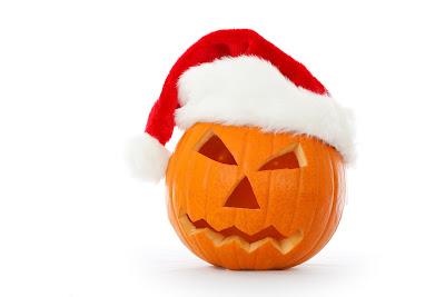A jack o' lantern wearing a Santa Claus hat.