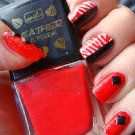 http://prettynailsbykasia.blogspot.com/2014/10/31dc2014-day-1-red-nails-rock-zebra.html