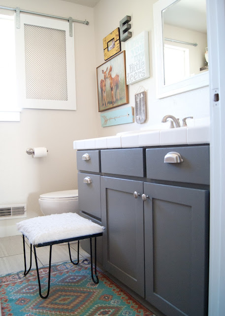 Project Kid's Bathroom Makeover - before & after - new tile, painted vanity, gallery wall, wood shelves and  antler organizers.