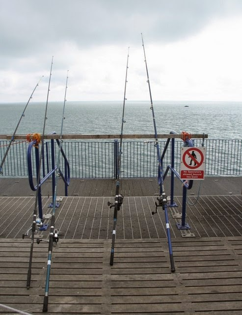 Fishing rods, Eastbourne Pier by Gerald Massey