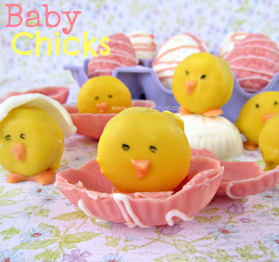 baby chick mini oreo dipped in yellow chocolate sitting on half a pink chocolate easter egg