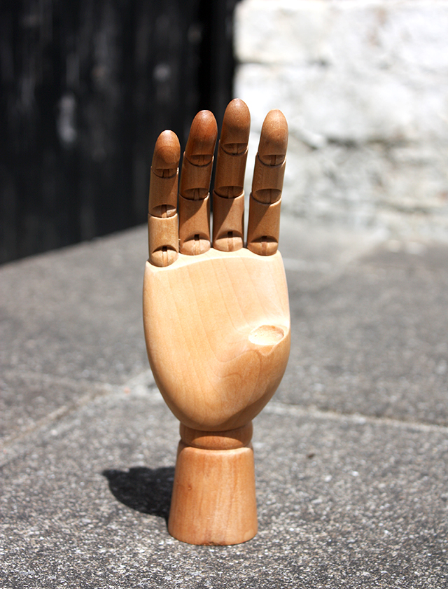 articulated wooden hand with broken thumb