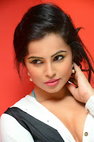 Haashika in lovely White Shirt unbuttoned Glamorous Photo shoot Portfolio
